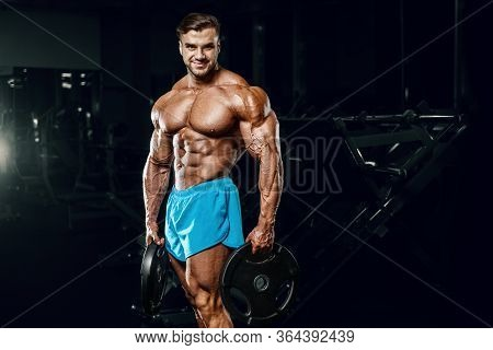 Good Looking Fitness Man Pumping Up Muscles