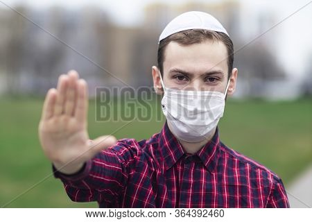 Handsome Young Jewish Guy In Traditional Jewish Male Headdress, Hat, Boom, Or Yiddish On Head. Man I
