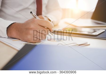 Businessman Working, Hand Pointing At Business Document, Paperwork, Working On Desk At Office With L