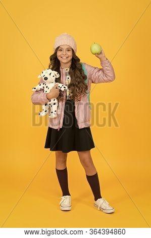Its Apple Season. Happy Schoolchild Hold Apple And Toy. Little Child With Vitamin Snack. School Snac