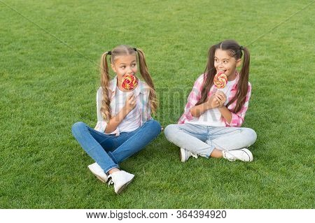 Sugar And Calories. Joyful Cheerful Friends Eating Sweets Outdoors. Holiday Food. Confectionery. Swe