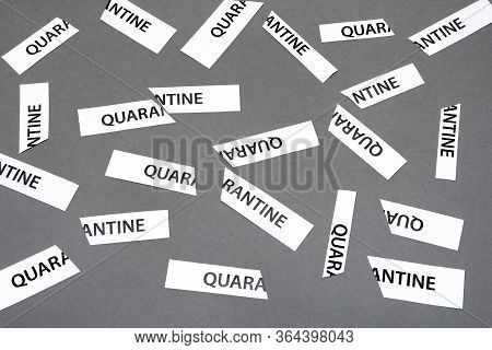 Word Quarantine Printed On Piece Of Papers Tored Apart As Quarantine Is Over. Back To Normal Life. Q