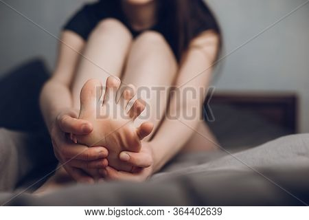 Close Up Woman Foot Massage To Relieve Pain From Ache. Tired Female Feeling Discomfort Rubbing Her S