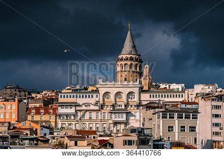 The Galata Tower And The Old Quarters Of Istanbul On The Background Of Dark Sky. Istanbul Before The