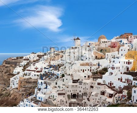 Panoramic View Of Oia Town At Sunset, Santorini Island, Cyclades, Greece. Traditional Famous White H