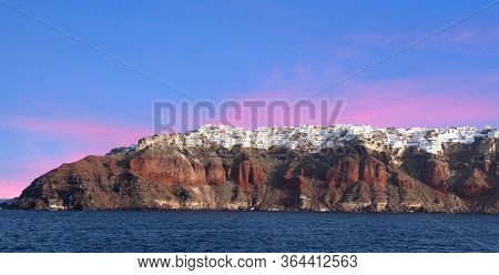 Santorini Volcanic Island At Sunset, Cyclades, Greece. Traditional Famous White Houses And Churches