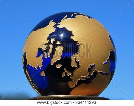 Planet Earth: Small Dark Blue Transparent Glass Globe With Golden Printed Shapes Of Continents Again