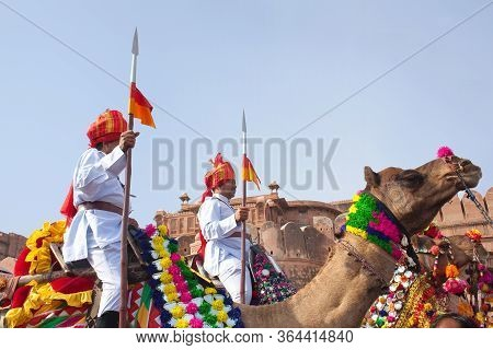 Bikaner, India - January 12, 2019: Indian Warriors Riding On Camels During Annual Festival In Rajast