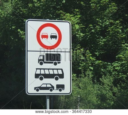 Traffic Sign No Overtaking With Explanation Under It. Refers To Trucks, Buses, Cars With Trailers. G