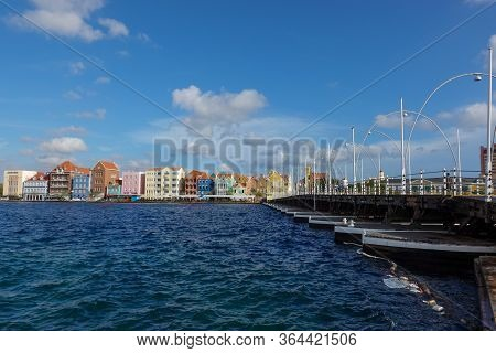 Curacao-11/3/19: Colorful Pastel Buildings On The Water In The Island Of Curacao Near The Queen Emma