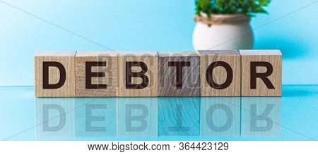 Debtor Word From Wooden Blocks With Letters, To Divide Or Use Something With Others Share Concept, B