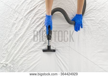 Vacuuming Bed. Domestic Home Cleaning Concept. Textile Sofa Chemical Cleaning. Upholstered Furniture