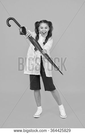 Small Schoolgirl Wear Water Resistant Clothes For Rainy Day. Cute Schoolgirl Feel Protected For Spri