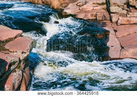 Waterfall Spring Water Landscape At The Daytime. Magmatic Stones Breed.