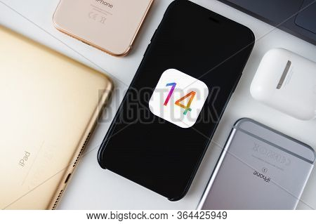 Iphone With Ios 14 Logo On The Screen Close Up, New Operating System 2020 On Apple Devices.