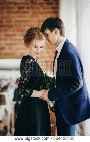 Happy Bride In Black Dress And Groom On Their Wedding,  Bridal Couple, Happy Newlywed Woman And Man.