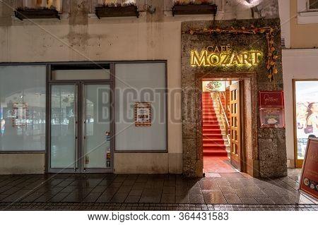 Feb 3, 2020 - Salzburg, Austria: Cafe Mozart Entrance In The Evening