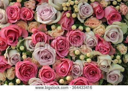 Pink And Purple Roses In A Big Wedding Centerpiece