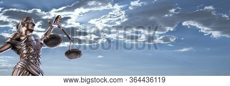 Bronze Themis Statue - Symbol Of Justice - With A Blue Cloudy Sky