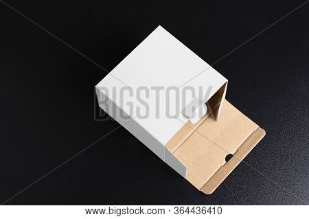 Lay Down Cubical White Box On Black Background, Mock Up Template