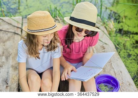 Summer, Vacation, Nature, Lifestyle, Childrens Leisure. Children, Two Girls Sitting On Wooden Pier I