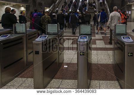 Athens, Greece - October 28 2017: Passengers On Metro Station With Ticket Validating Tvc Gates. Atti