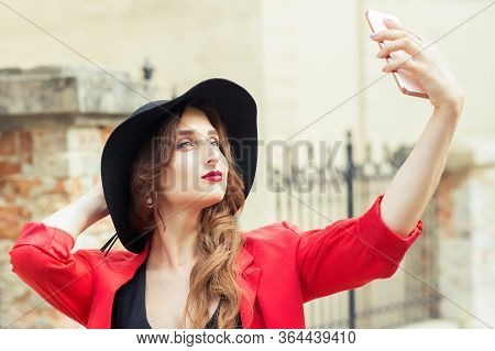 Close Up Portrait Of A Beautiful Young Woman Is Posing And Makes Selfie. Beauty Girl Makes Selfie Fo