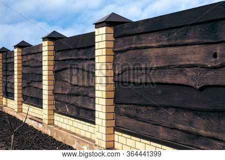 Strong Wooden Fence With Brick Posts Horizontal Boards Are Tightly Nailed To Each Other And Provide