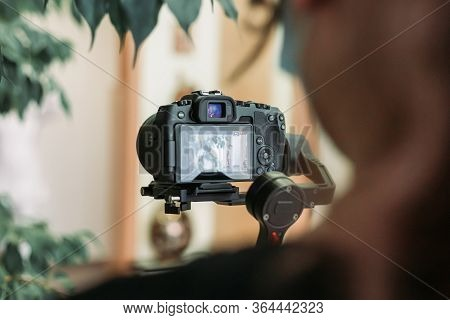 Videographer Recording Video On The Site With Mirrorless Camera Using Gimbal. Blogging, Vlogging