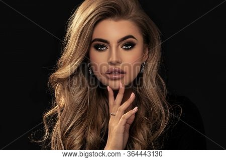 Elegant Woman With Long Wavy Hair.