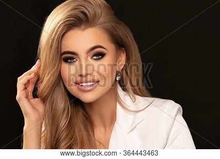 Elegant Woman With Long Wavy Hair.