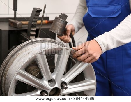 Mechanic Working With Car Disk Lathe Machine At Tire Service, Closeup