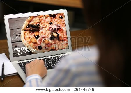 Woman Using Laptop For Online Food Order During Quarantine, Closeup. Delivery Service