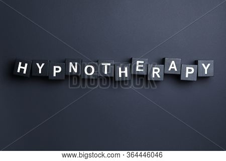 Wooden Blocks With Word Hypnotherapy On Black Background, Flat Lay