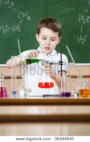 Little chemist holds scientific experiment