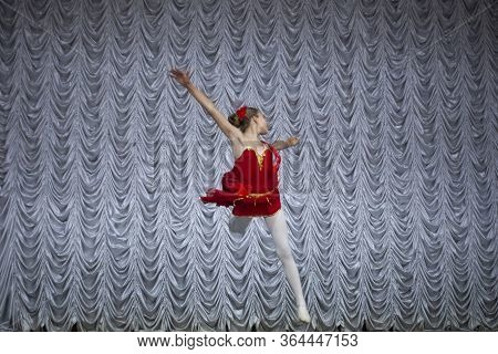 Classical Dance Of A Young Girl. Beautiful Movements On Stage. Flexibility And Plasticity Of A Woman