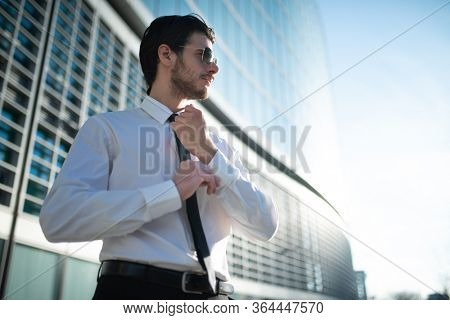 Detail of a businessman adjusting his shirt's cuff