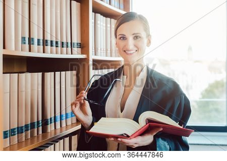 Lawyer working on a difficult case reading in the library of law firm