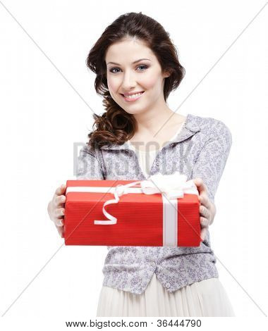 Young woman proffers a gift wrapped in red paper, isolated on white