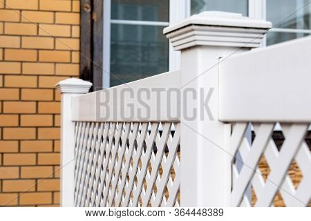 Fragment Of A White Plastic Fence In A Modern Cottage Village.