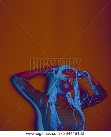 Girl With Dreadlocks, Pigtails Dancing, Model In The Style Of The 80s. 90s, With Bright Blue Make-up