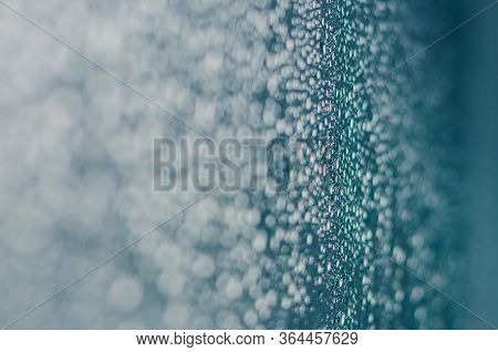 Blurred And Focus Of Rain Drop On Glass Window In Monsoon Season For Abstract And Background Concept