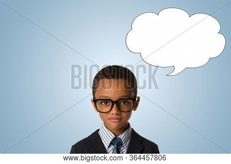 Childhood And People Concept-little African American Boy With Glasses In Business Suit Over Blue Bac