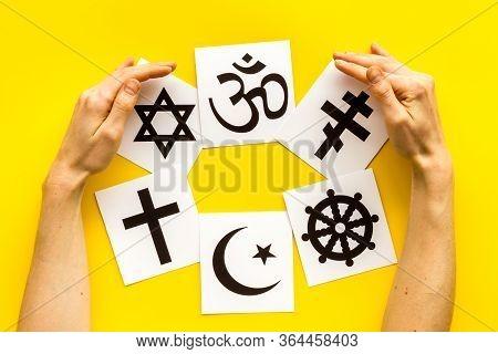 World Religions Concept. Hands Hugs Christianity, Catholicism, Buddhism, Judaism, Islam Symbols On Y