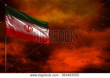 Fluttering Iran Flag Mockup With Blank Space For Your Data On Crimson Red Sky With Smoke Pillars Bac