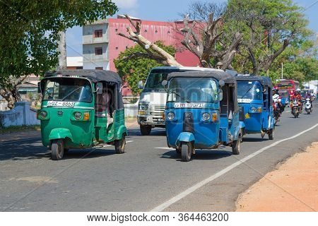 Trincomalee, Sri Lanka - February 10, 2020: Tuk-tuks In Motion On A City Street On A Sunny Day