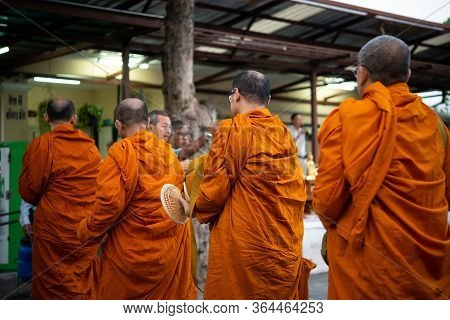 Bangkok, Thailand - January 1, 2020 : Unidentified Thai Monk Ask For Alms In Morning For Buddhist To