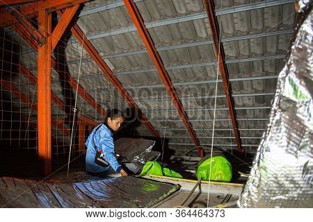 Worker Install Thermal Heat Insulation On Roof