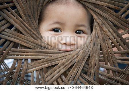 Closeup Portrait Of A Cute Little Thai Girl, Still Life