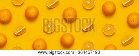 Fresh Juicy Whole And Sliced Orange On Bright Yellow Background. Fruit Pattern, Creative Summer Conc